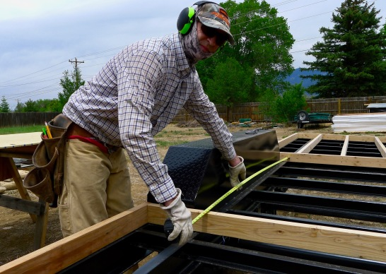Brad working on the subfloor framing.