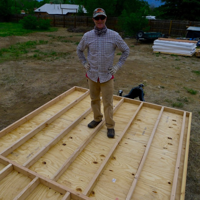 Brad celebrating completion of one stage in the subfloor framing.