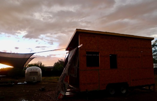 Tiny house and Airstream during sunset.