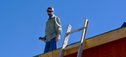 Brad during installation of the metal roofing panels.